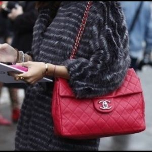 Chanel soft caviar maxi red pushia color bag.
